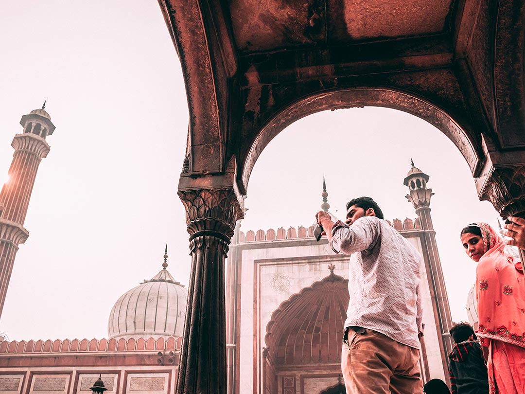 Editorial photo: Male in India taking photos