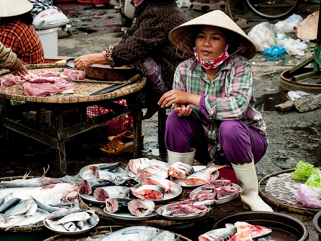 Photo: Fish market vendor - Things to know before moving to an Asian locality