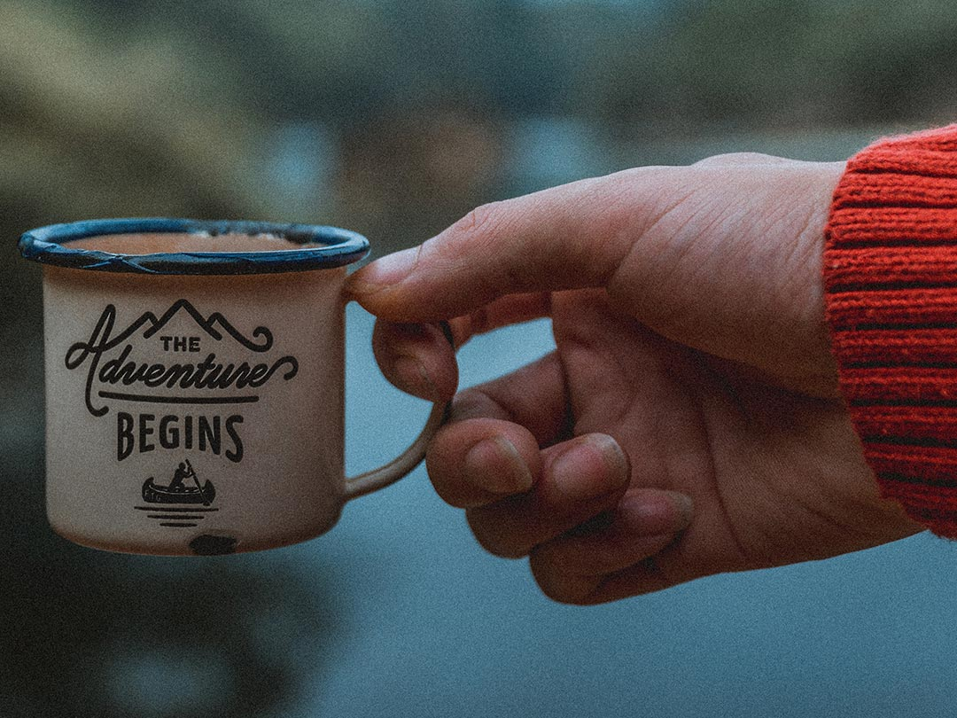 Photo: Hand holding mug - Things to know before moving to an Asian locality