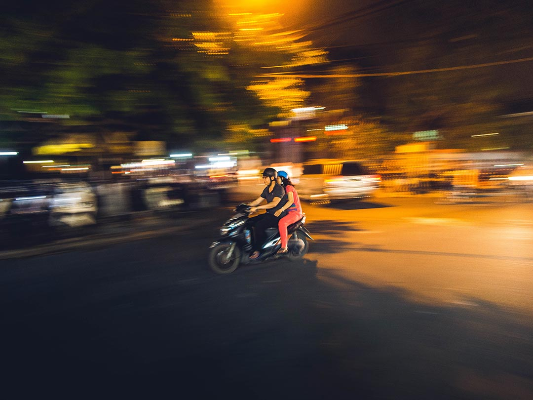 Editorial photo: Vietnamese youths double-riding on an electric scooter