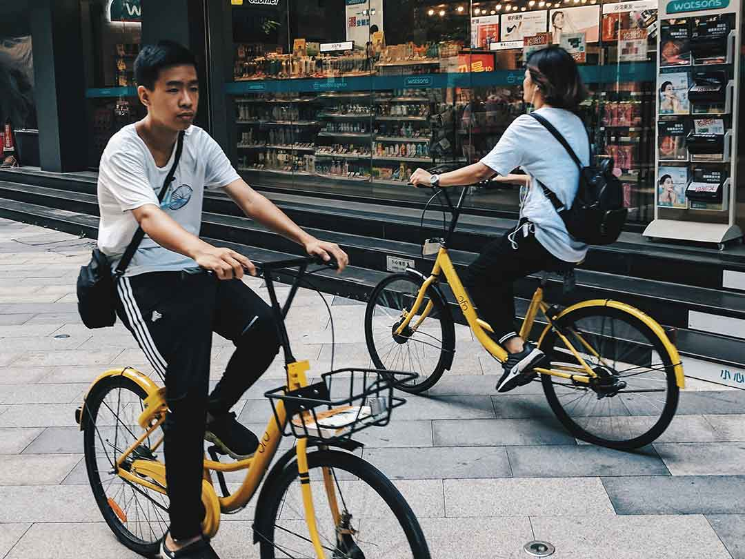 Editorial photo: riders using OFO bike sharing