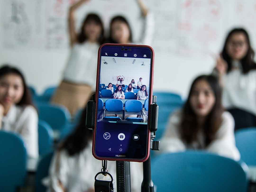 Editorial photo: Smart phone taking group photo on self-timer